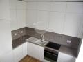 Šilto atspalvio balta virtuvė 1